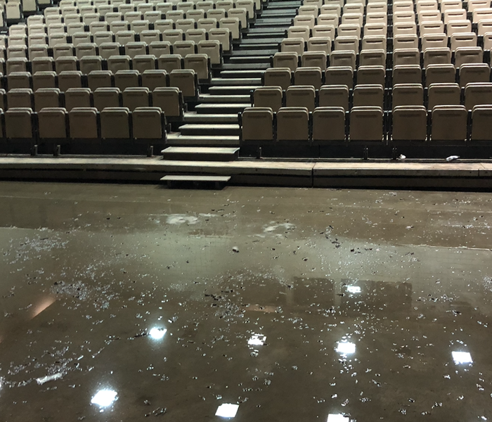 stadium seating with standing water on the floor