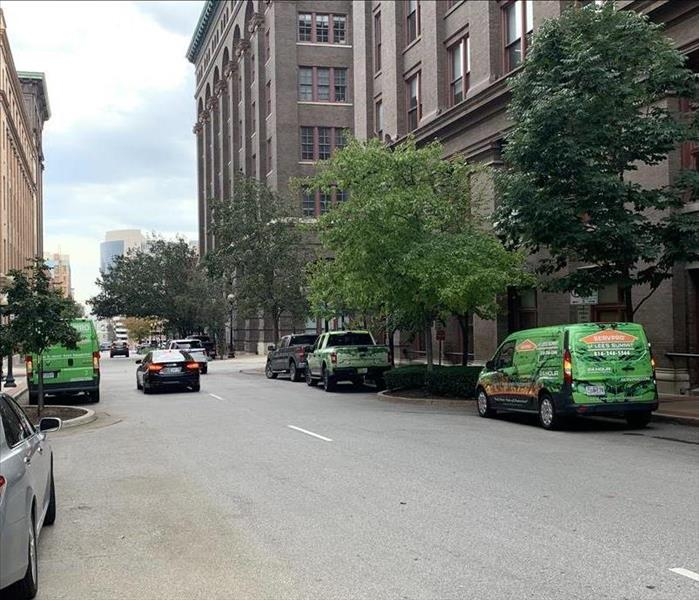 3 green SERVPRO vans in front of a commercial building