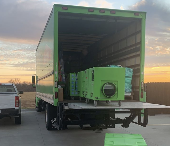 a servpro truck with a sunset in the background