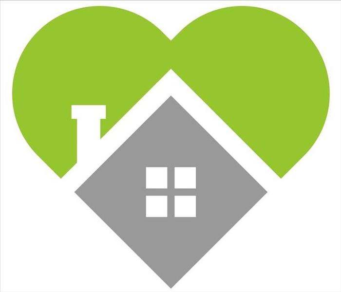 Green heart with grey house